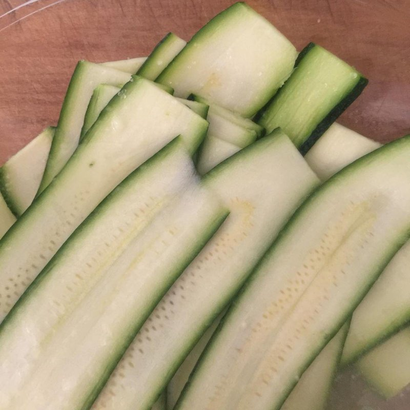 A favourite summer salad, super thin slices of zucchini bathing in lemon juice and a little salt, to be joined in an hour or so by lettuce, shavings of parmigiano and good oil.