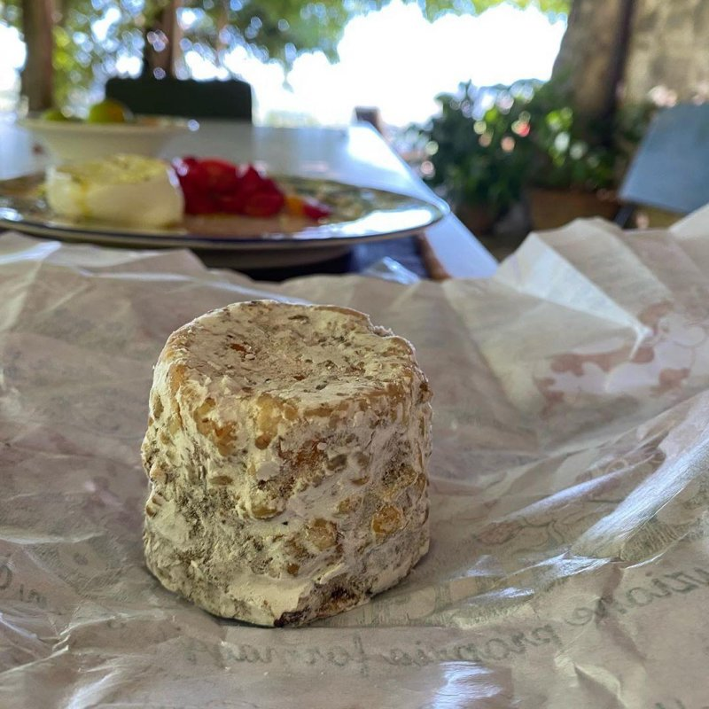 An aged goat cheese that was nothing like I expected and extremely good.